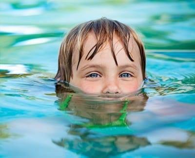 girl swimming and smiling eyes